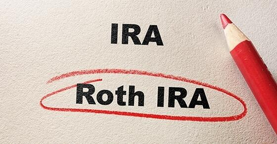 "Red colored pencil resting on paper with ""Roth IRA"" circled, IRA not circled"