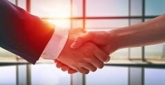 Closeup of a handshake between two business professionals.