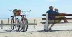Elderly couple on a bench, two bikes sitting next to them